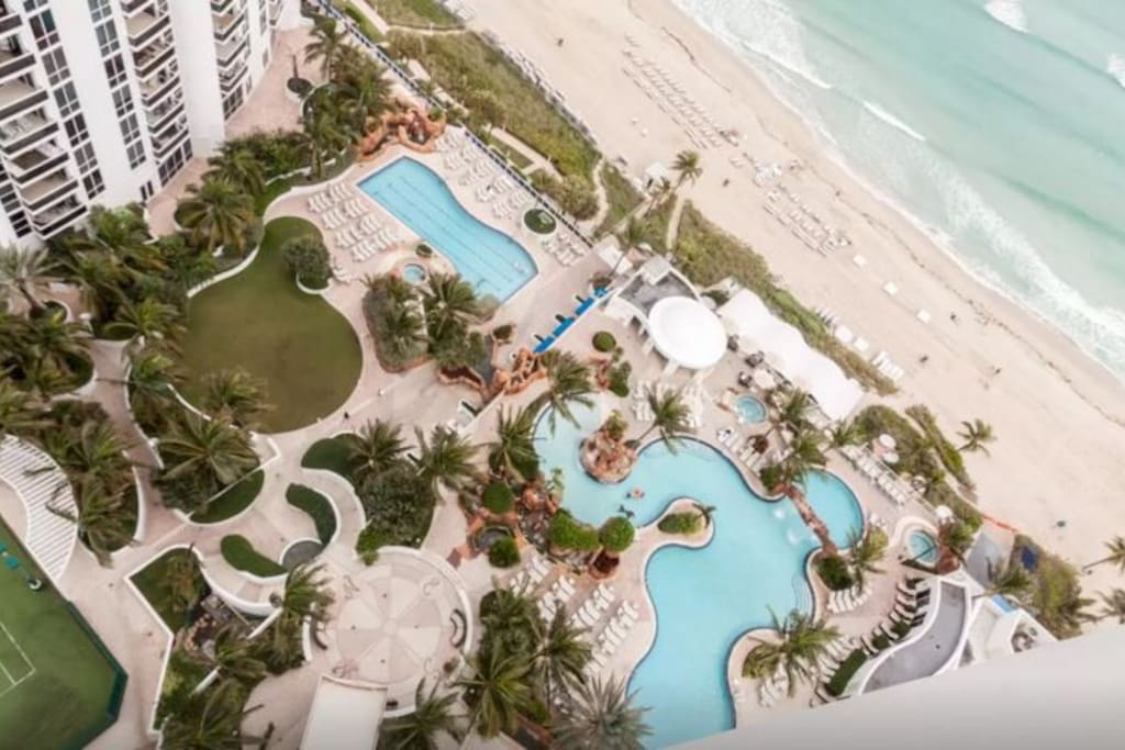 Top view of the resort's beautiful outdoor pools and beach amenities