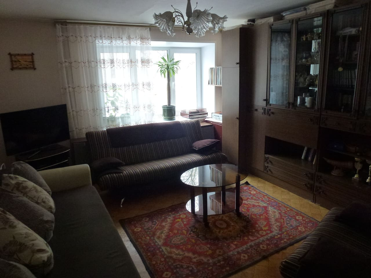 Large and sunny living room. Could create more of free space by taking front sofa away. Grate to spend evening with company using both.