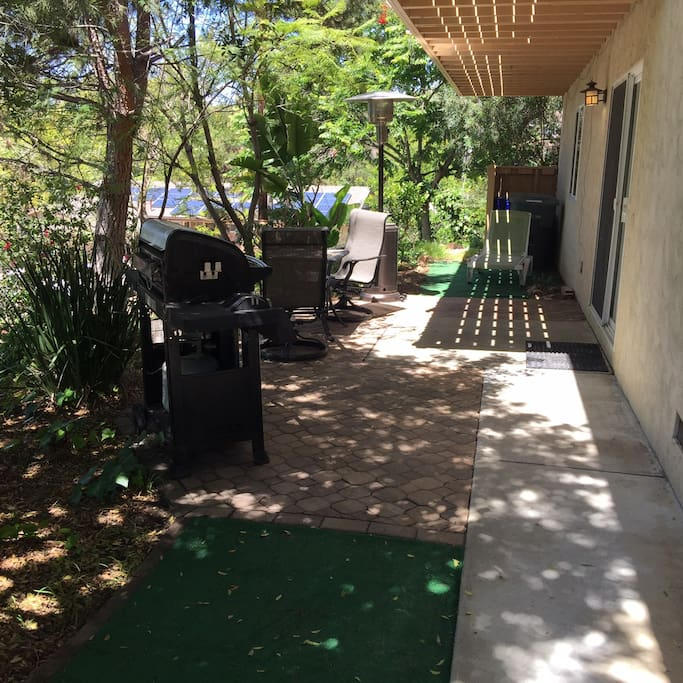 Enjoy sitting on patio, barbequeing or taking swim at pool next door