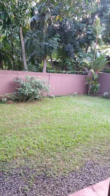The front yard and entire home is enclosed by a gated wall.