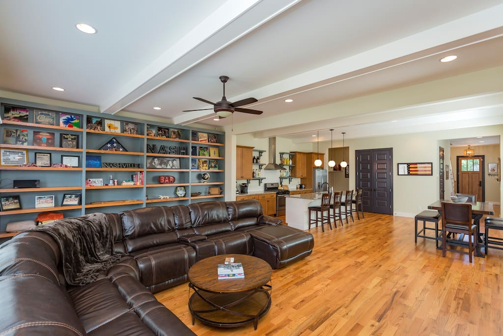 Open floor plan Kitchen and Huge leather sectional with chase lounge