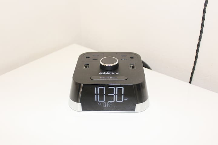 Alarm clock with USB outlets for easy charge of devices