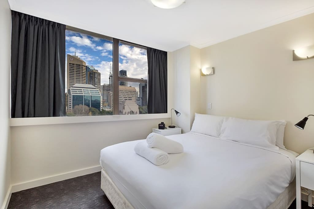 Separate bedroom with large windows providing views over to Hyde Park