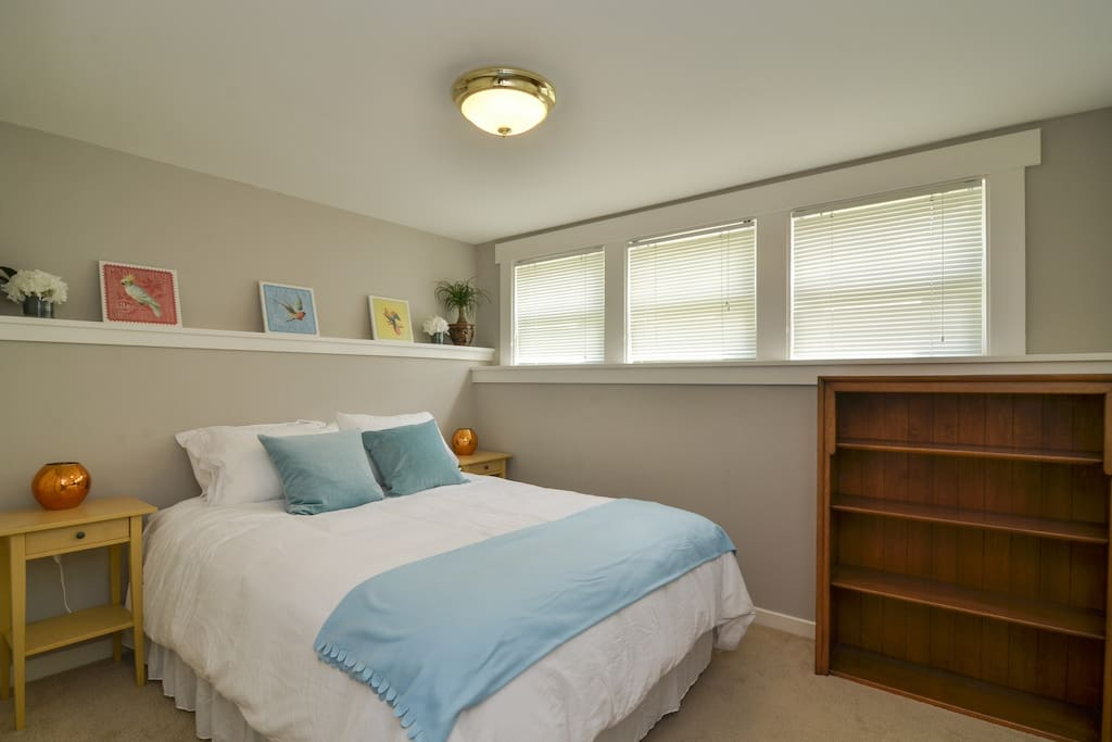 The charming Tropical Bedroom has a full sized closet to store your items during your stay.