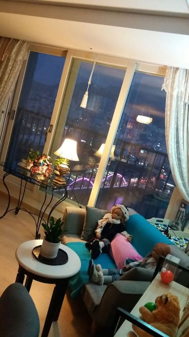 Busan City light from the living room at night. Guests are privillaged to see my doll collection from all around the world . they are mostly  hard to find.
