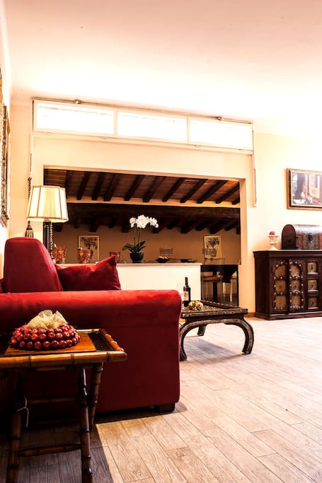 Living area with Duomo View. It has a full equipped kitchen, Air Conditioned, 2 sofas, large table, chairs. Wifi internet, decorations.