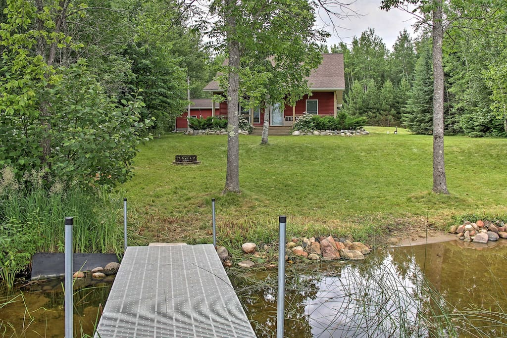 The spacious 1,490-square-foot property offers up to 8 guests the ultimate lake experience with a wood burning stove, 2 stand up paddle boards, row boat, fire pit, dock, and a gorgeous yard overlooking the calm waters of the lake!