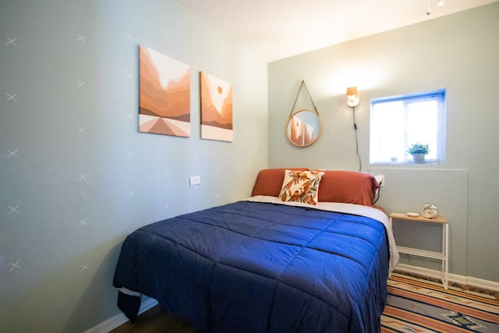 2nd bedroom with full size bed & closet with hangers for guest use.