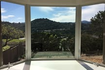 Panoramic view from your bed through bay window (headboard is facing the bay window for you to savor the view and sunset)
