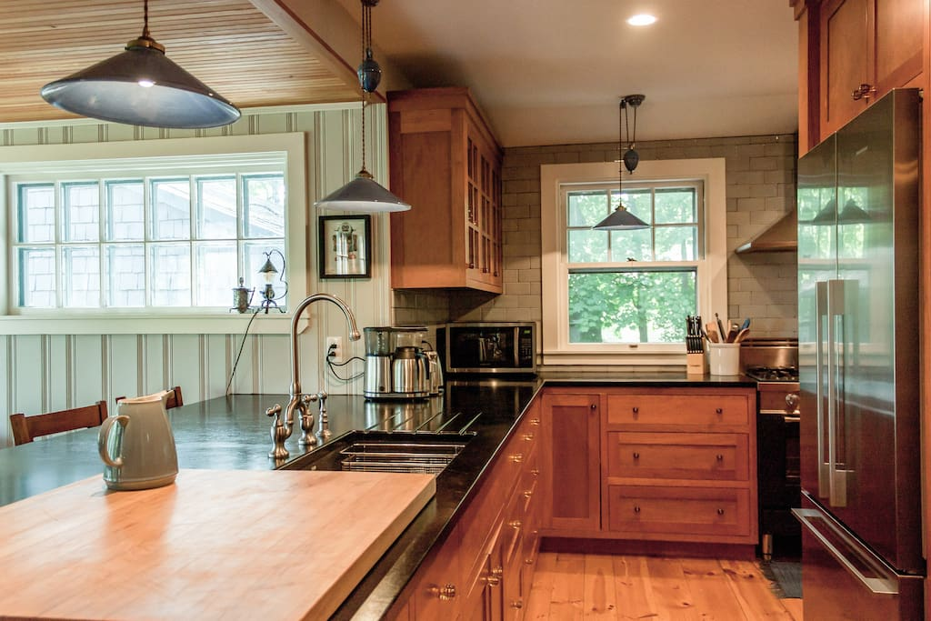 An open kitchen features upscale appliances to impress the chef in your group.