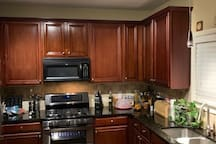 Kitchen w/black and stainless steel appliances (refrigerator, dishwasher, microwave, gas range w/double ovens and double drawer wine cooler/beverage center)