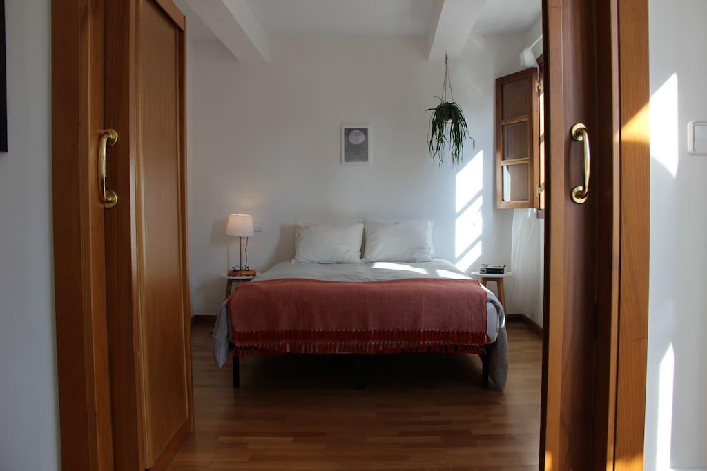 Bedroom with sliding doors.