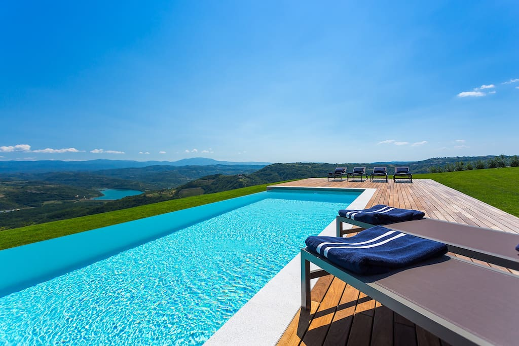 swimming pool with the view of the lake