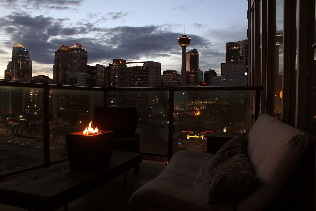 Cozy outdoor patio with BBQ, seating and amazing views of downtown and mountains