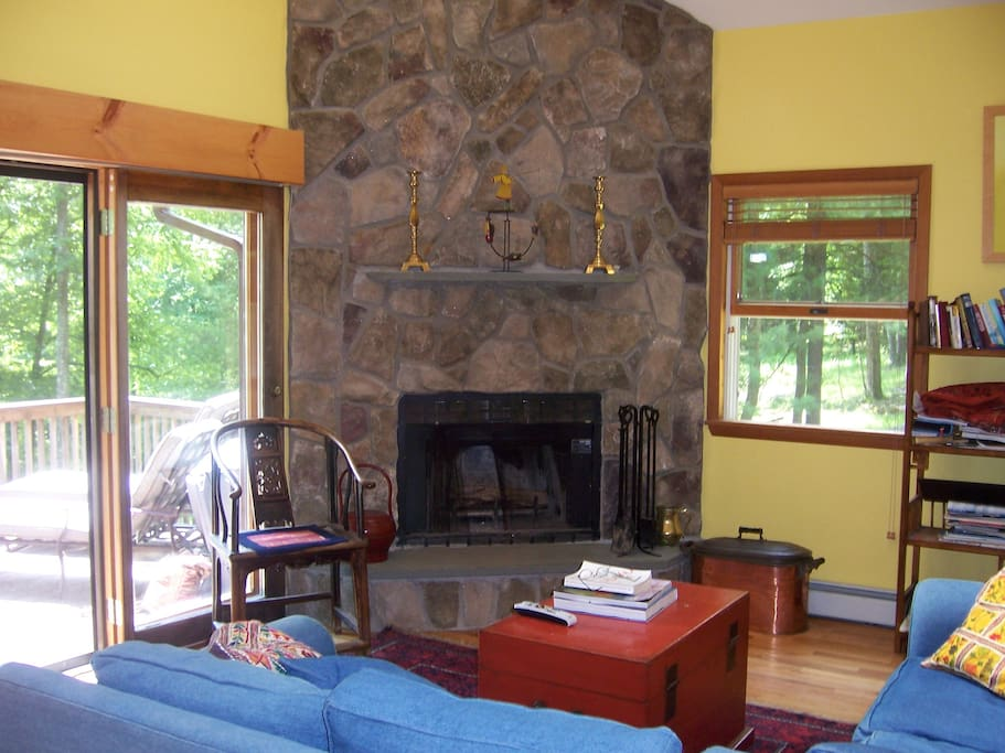 stone fireplace, wood supply near under deck