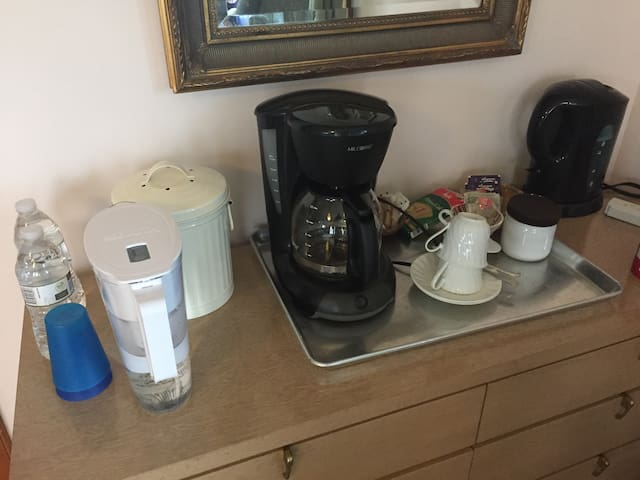 Coffee, tea, filtered water, compost bin