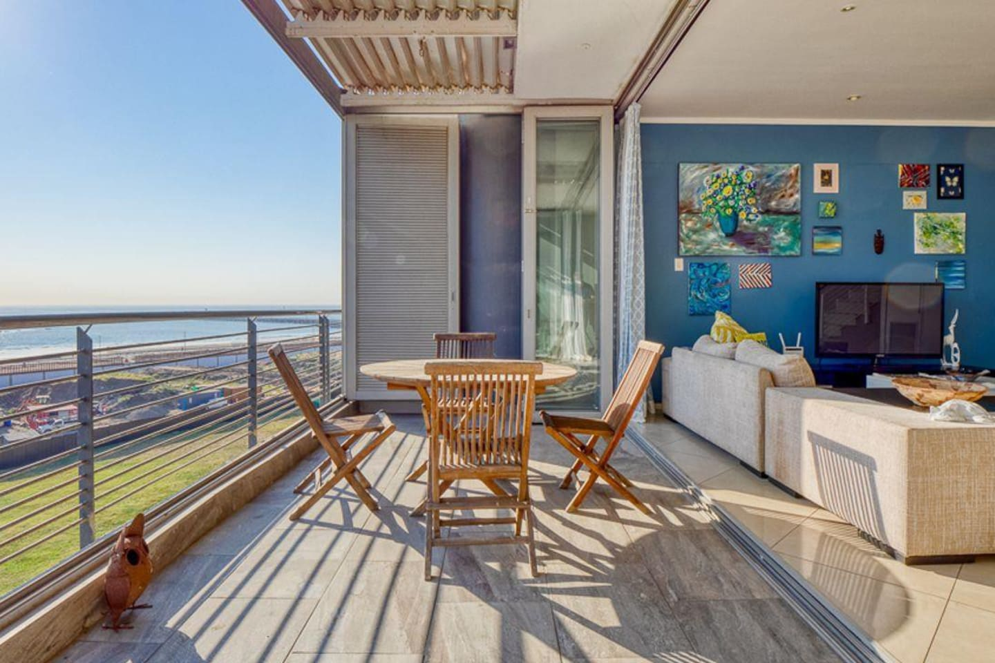 The large lower level living room opens onto the balcony overlooking the newly completed promenade and ocean.