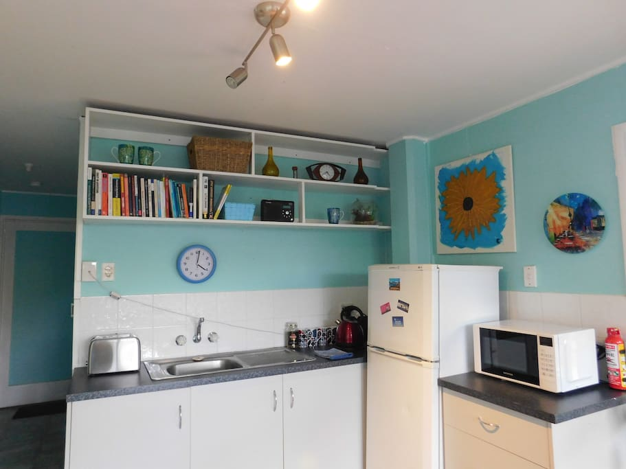 The kitchen area has fridge/freezer, microwave, toaster and kettle