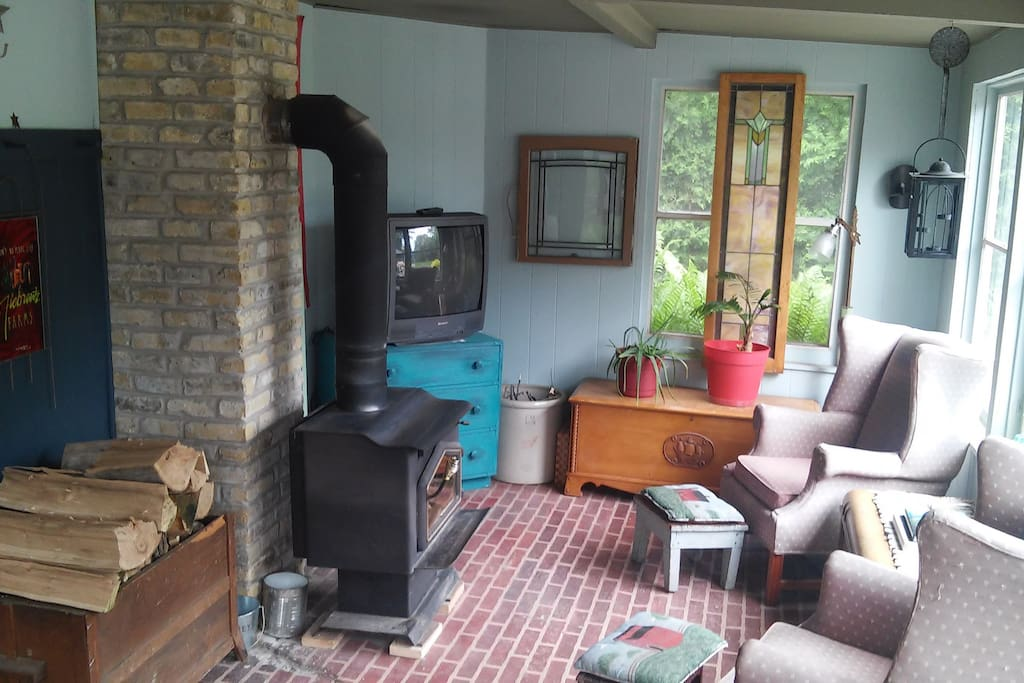 2nd TV room with wood burning stove to keep toasty in the cooler months