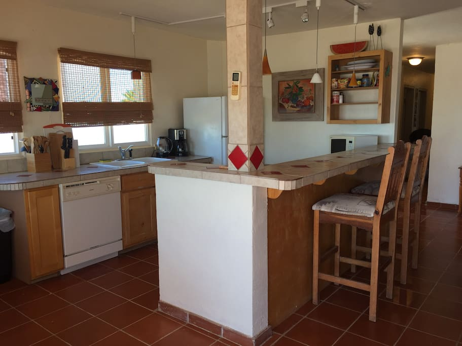 Kitchen is equipped with dishwasher, garbage disposal, fridge, and micro.