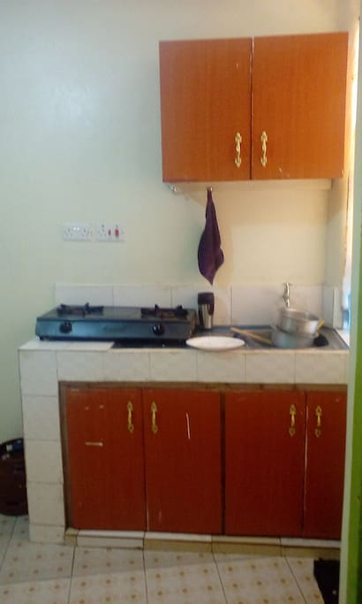 Kitchen fitted with drawers for storage,gas and two cooker burners provided