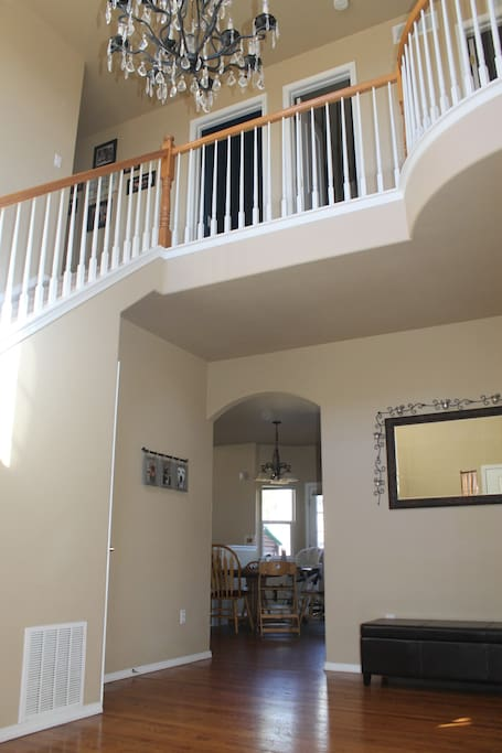 Grand front entry with vaulted ceiling.