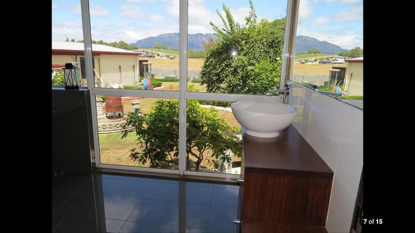 Bathroom with views over garden and mount Roland