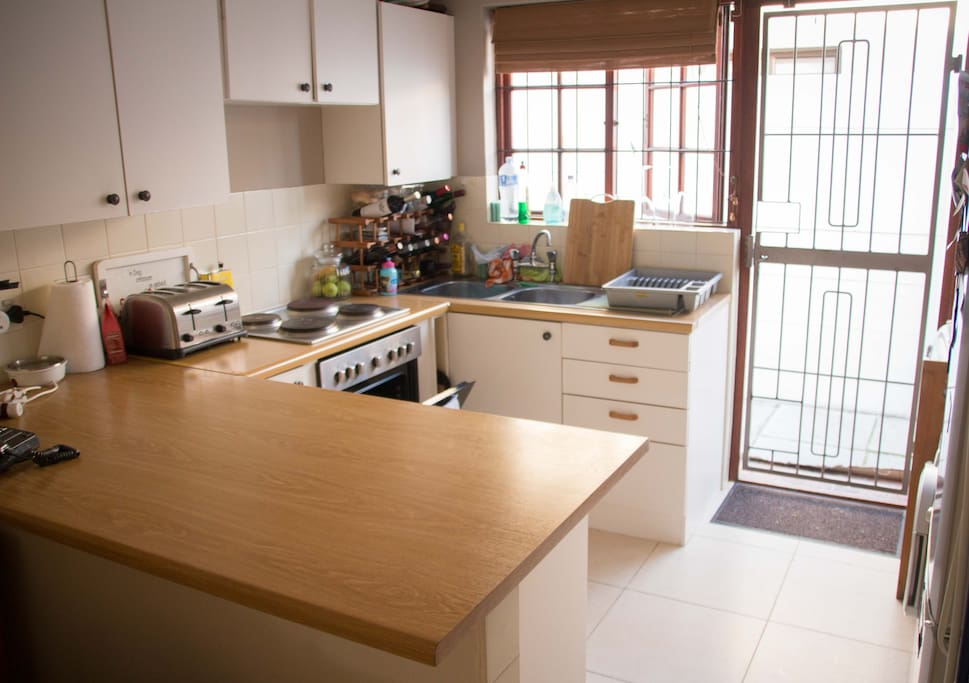 The kitchen has all amenities, such as a dishwasher, washing machine, fridge and microwave oven.