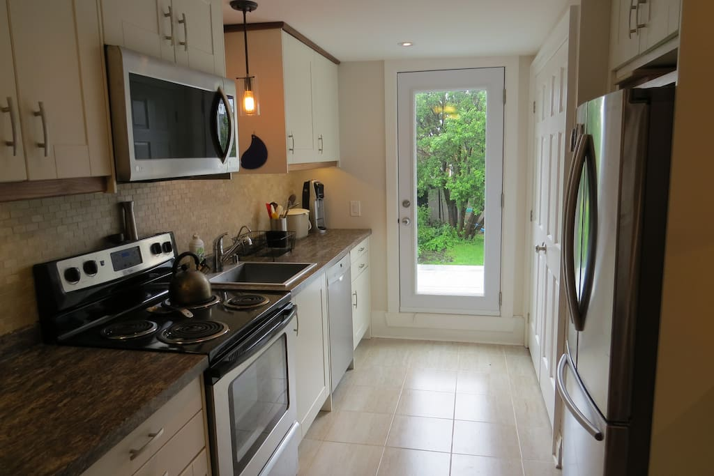 Kitchen with door leading to deck (deck is now available to guests)