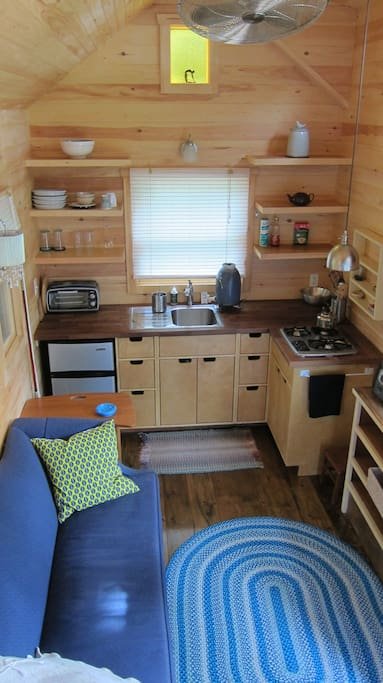 Your own private tiny house.  Propane gas stove and hot water heater.