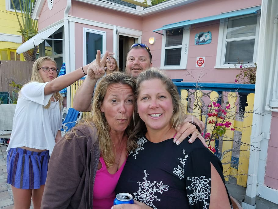 Guests having fun outside Pink Dolphin Cottages