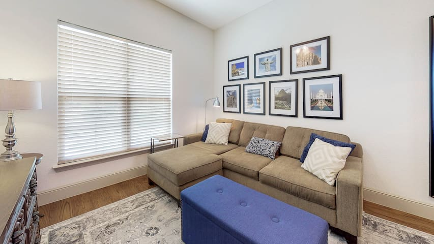 The sofabed has a full size mattress. The linens are located in the blue ottoman in front of the sofa.