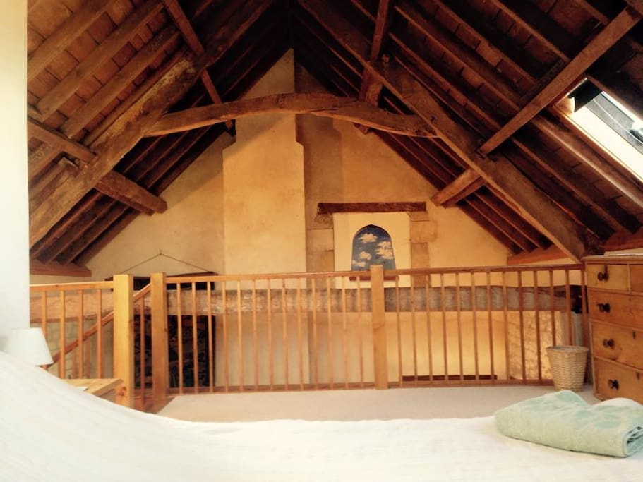 Vaulted wooden-beamed ceilings throughout