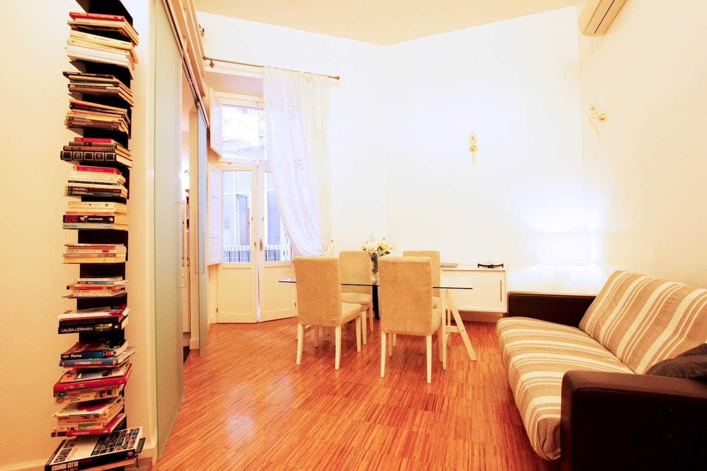 Spacious and comfortable living room with dining area.