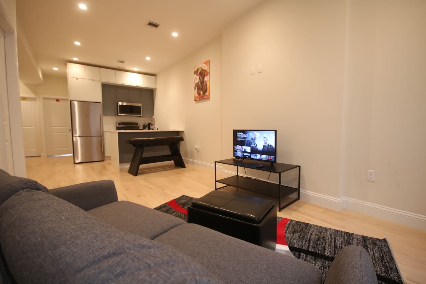 Beautiful and modern living room area with free Netflix movies and shows. Open space kitchen with stainless steel appliances. Coffee maker and toaster included.