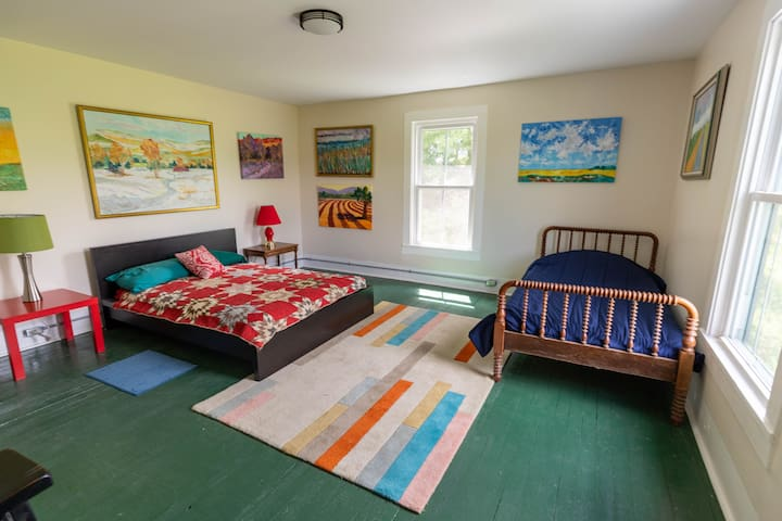 Upstairs bedroom with double bed and twin bed.
