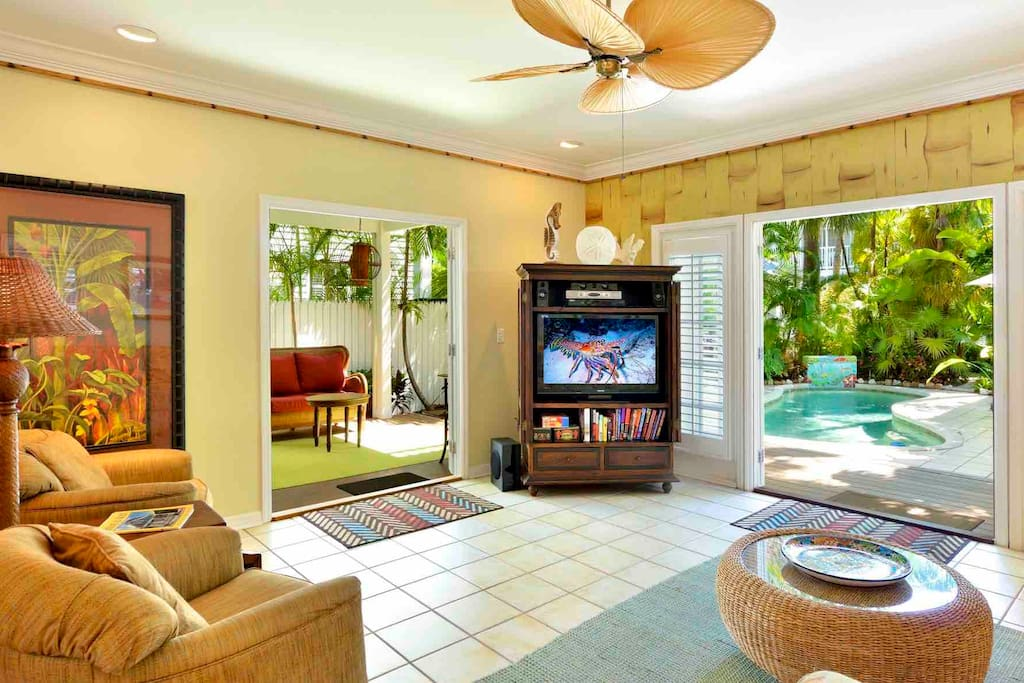 French doors let in those wonderful tropical breezes. Note large flat screen TV...