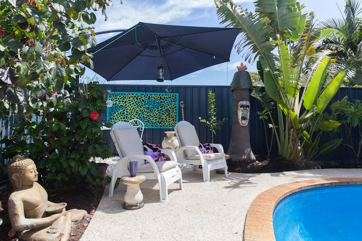 Cool cottage with gardens and shared pool.