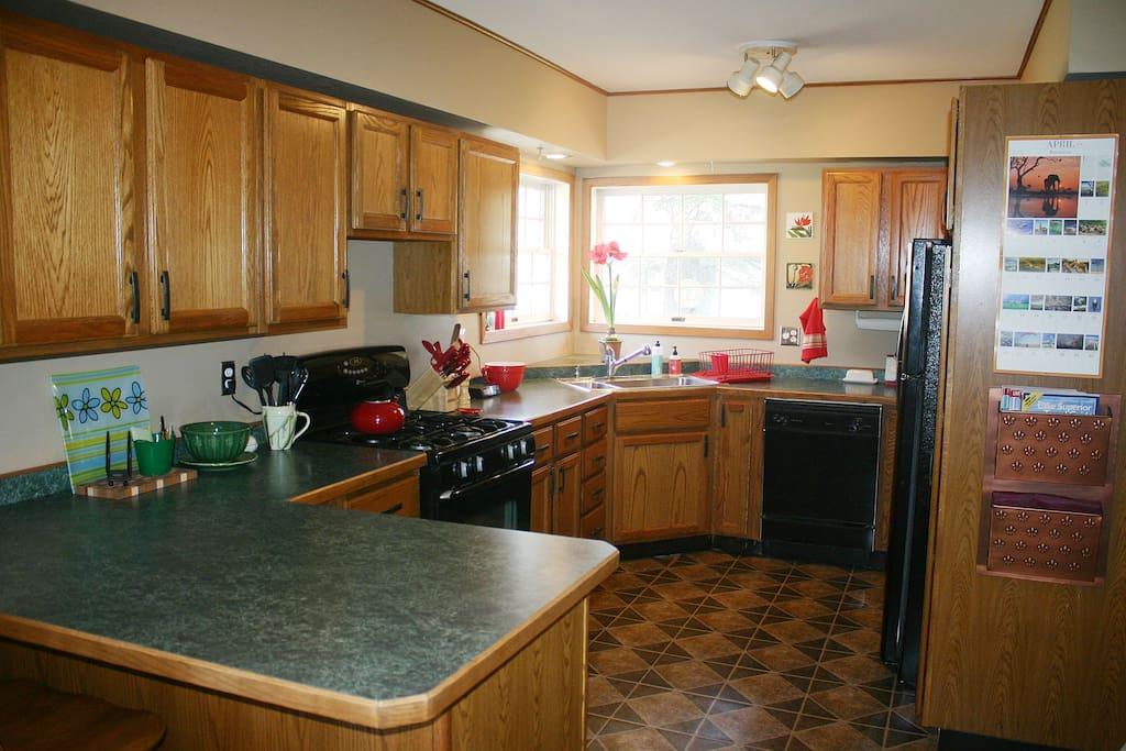 Our kitchen has a dishwasher, microwave, gas range and lots of cookware.