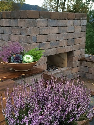 Outdoor fireplace for summer and winter use