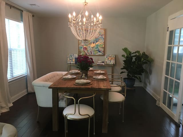 Dining room features comfortable stylist dining area for 6 guests along with a bar area that seats 2 persons.