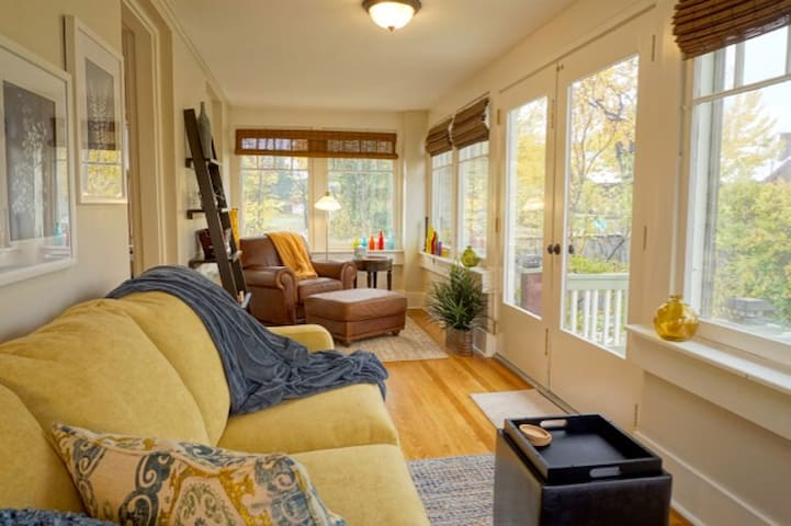 Enjoy a good book (or good conversation) in the bright sunroom.