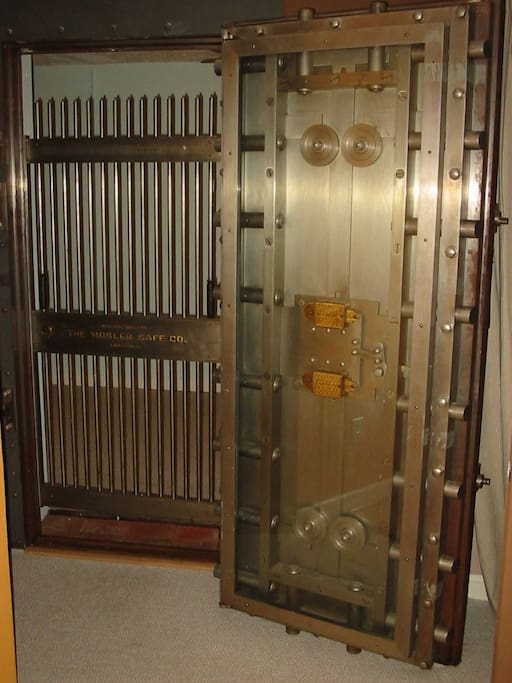 Bank vault door between beds