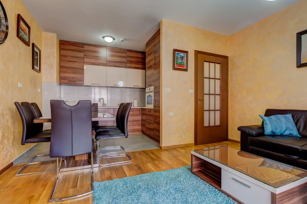 In the living room there is a comfortable leather corner set, table and flat screen TV with cable television.