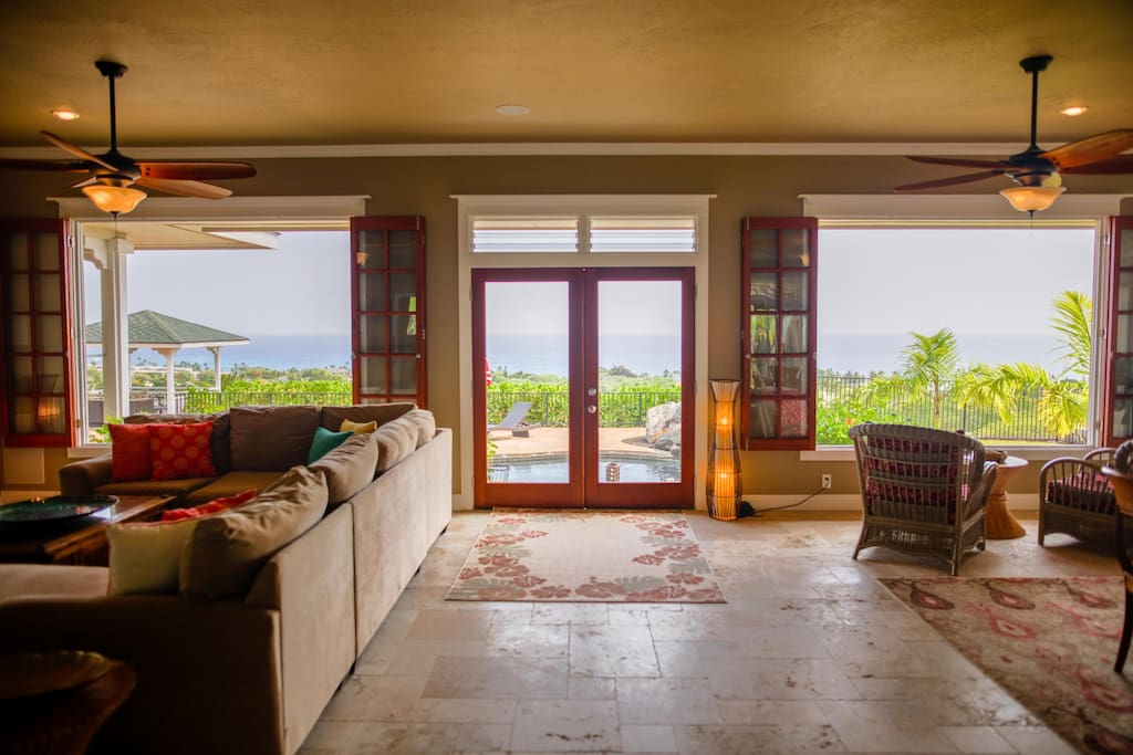 Massive Living Rom with lovely ocean view. Steps to the private pool.