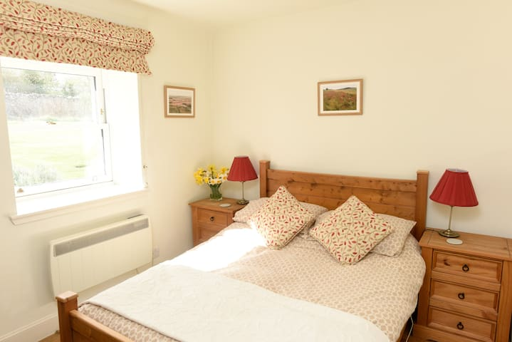 Double bedroom with view out to private garden