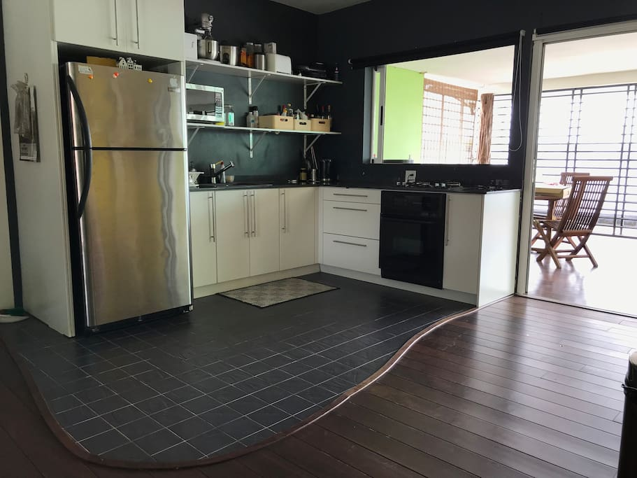 Open kitchen with ample appliances