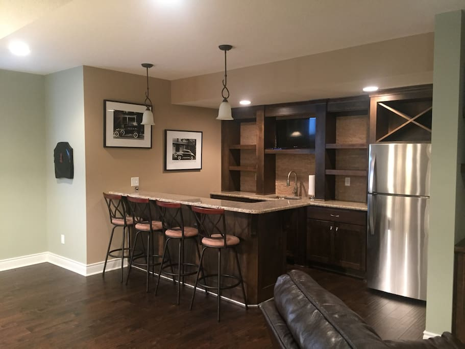 Two tv's, refrigerator, and bar all yours