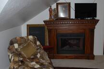 Chaise and fireplace... what a better place to relax!