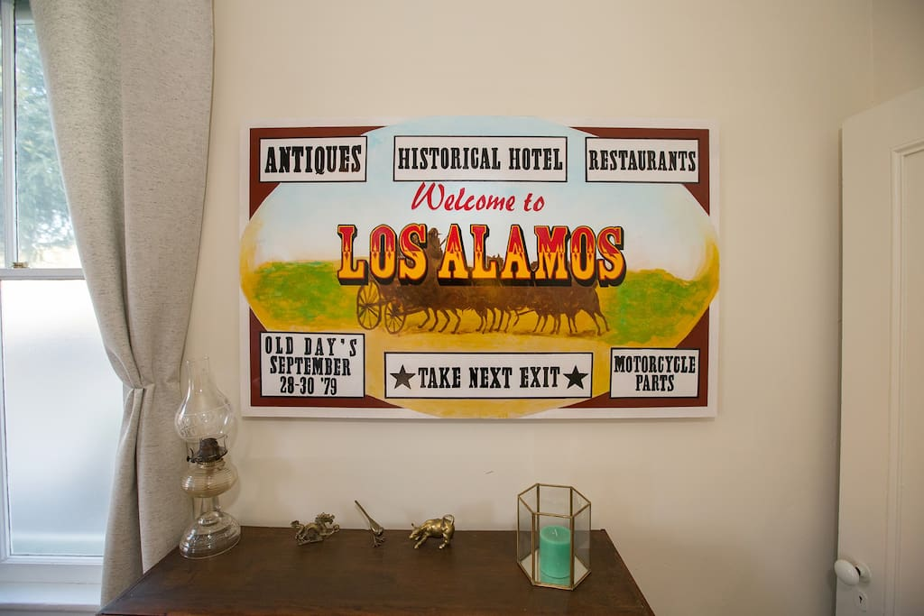 We had the Los Alamos welcome sign recreated for the living room.